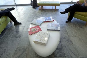 """Throughout the Museum there are """"reflection areas"""" set up where visitors can take a break and look through art books and museum information on iPad's on the walls."""