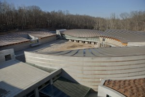 The Museum is made up of a collection of buildings and is nestled into a wooded ravine in Bentonville.