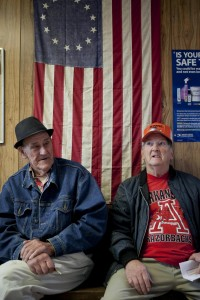 J.D. Sutterfield(left) and Rip Bonds(right) wait for their mail to be put into their PO boxes Friday at the Fox, AR Post Office.  The two said they do not want to get a mailbox they want their Post Office to stay open.