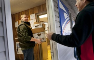 Flint Bradford gets his daily mail delivery from mail driver David Schmidt.